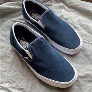 Navy blue suede Vans slip-ons